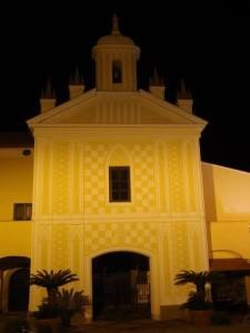 We think it is a church, a yellow church. While you cannot see it, there was a gecko on the wall of said church.